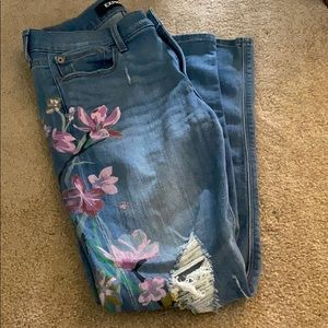 Like new express flowered skinny jeans